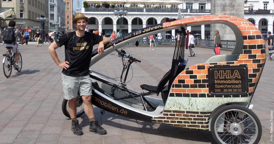 Tilman Hagner mit seinem Fahrradtaxi auf dem Rathausmarkt